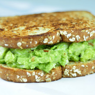 AVOCADO SANDWICH WITH HARD BOILED EGG.