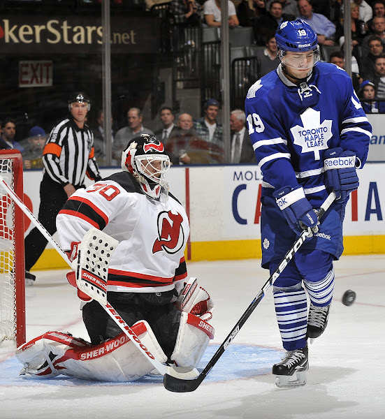 Photo: TORONTO, CANADA - FEBRUARY 21:  Joffrey Lupul #19 of the Toronto Maple Leafs is stopped in close by Martin Brodeur #30 of the New Jersey Devils during NHL game action February 21, 2012 at the Air Canada Centre in Toronto, Canada (Photo by Graig Abel/NHLI via Getty Images)