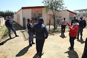 Police arrive at the house where false reports claimed that Ethopian nationals were keeping abducted children