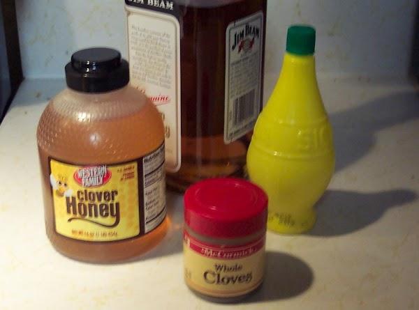 Pour bourbon,cloves, honey and lemon juice into a  large mug.Top it off with...