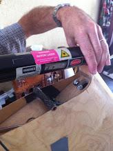 Photo: mise en place du lazer pour parallélisme des roues/fuselage