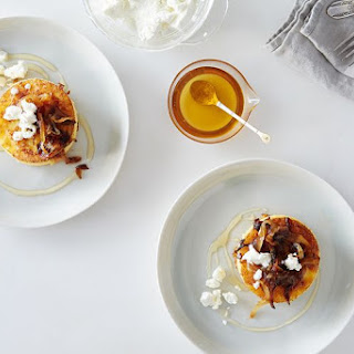 Griddled Polenta Cakes with Caramelized Onions, Goat Cheese, and Honey.