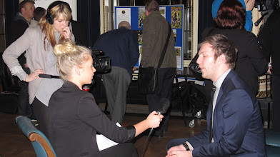 Photo: Trent University students interviewing people at the Celebration