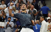 Serbia's Novak Djokovic reacts after his win against Japan's Kei Nishikori during the Men's Singles Semi-Finals match at the 2018 US Open at the USTA Billie Jean King National Tennis Center in New York on September 7, 2018.
