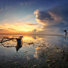 The Landscaper by Arya Satriawan - Landscapes Sunsets & Sunrises ( water, clouds, reflection, nature, color, sunset, seascape, boat, landscape, people )