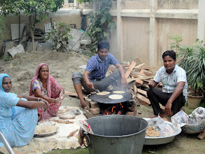 Photo: Each day they would prepare and bake the Roti (bread) right there at the conference with this open flame.