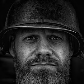 by Marco Bertamé - Black & White Portraits & People ( sobriety, severity, close up, beard, portrait, ww1, spotting, soldier, headshot, helmet, looking, military, man, bearded man )
