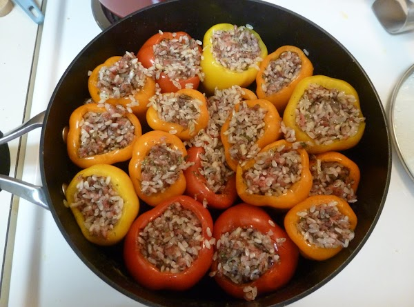 Fill the peppers with the rice mixture (but don't pack them too tight so...