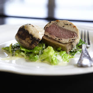 Vension and Veal Stuffed Portobellos with Savoy Cabbage.