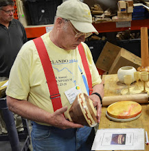 Photo: Bob tried using plans to design a piece for the first time.  Here he looks at the plans as he holds his segmented piece that he made from them.  It looks exact from here.