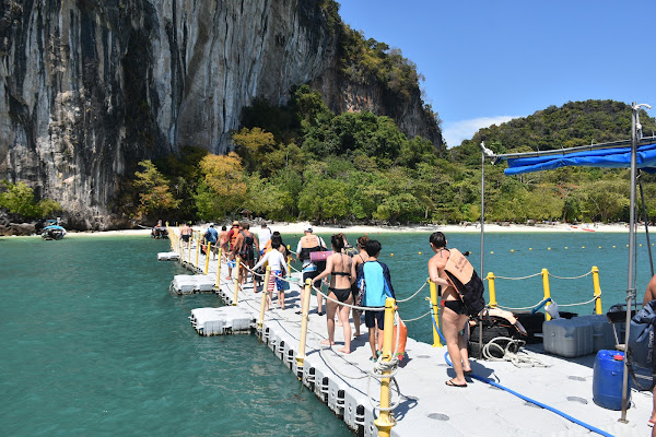 Walk on the floating bridge from the pontoon to shore of Koh Hong