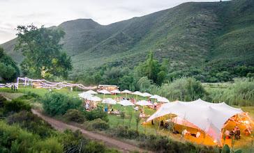 Photo: Layout of the picnic wedding with food truck, parasols & freeform tent.