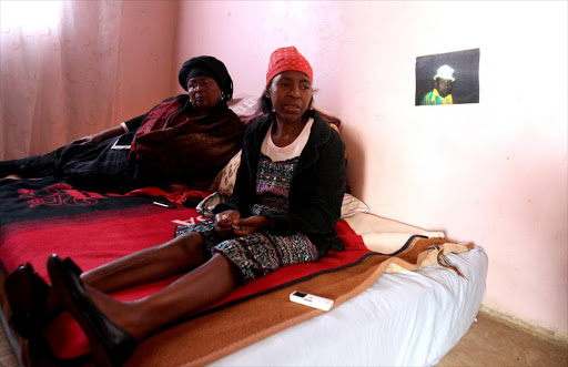 Zodwa Moloi, right, the mother of Lerato Moloi - who was found murdered at the weekend, is supported by Thandi Mathanjana at her home in Protea, Soweto. Picture Credit: Sandile Ndlovu