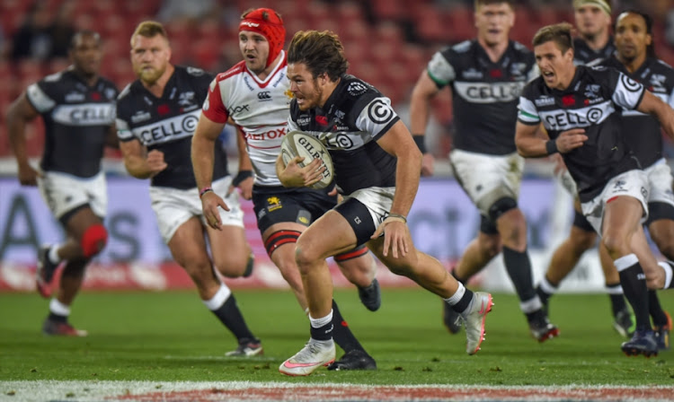 Marius Louw of the Cell C Sharks on the attack during the Currie Cup match between Xerox Golden Lions and Cell C Sharks at Emirates Airline Park on August 12, 2017 in Johannesburg, South Africa.