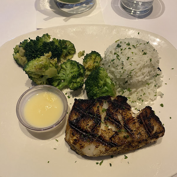 Chilean sea bass with lemon butter on the side, broccoli, and jasmine rice