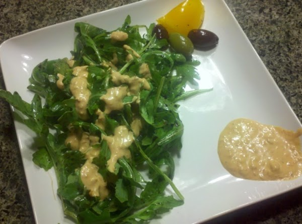 In a bowl, add your arugula greens. Add the balsamic, oil and pinch of...