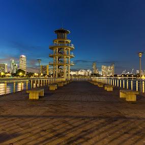 by Richard Amar - City,  Street & Park  Neighborhoods ( twilight, lighthouse, canon eos 5d mark iii, jetty, canon ef17-40mm f/4l usm, dusk, singapore, canon gps receiver gp-e2, leading lines, vanishing point, starbursts, long exposure, tanjong rhu )