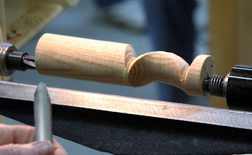 Photo: An example of an arc made by turning a cove on one axis and a bead on a parallel axis.
