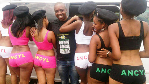 ANC Youth League deputy president Desmond Moela with women showing off their branded underwear