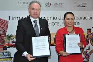 ROBERTO ZAPATA y Liliana Romero.