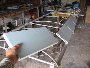 Photo: Bloop 2 leading edge construction. These blocks of blue Styrofoam are attached between the ribs with epoxy glue, then shaved down to the rib contour with a hand tool (Surform shaver).  A lot of this foam is going to end up on the floor (it's a big mess!) . Filling and sanding will later create a smooth curved surface. This leading edge shell is non-structural, it just holds the airfoil shape at the front of the wing.