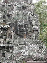 Photo: Faces at Bayon, this one is smiling.