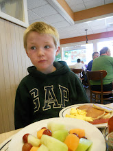 Photo: Nathan was overwhelmed. I asked for a side of fruit with his breakfast and we thought it would be a kid sized side not a full serving.