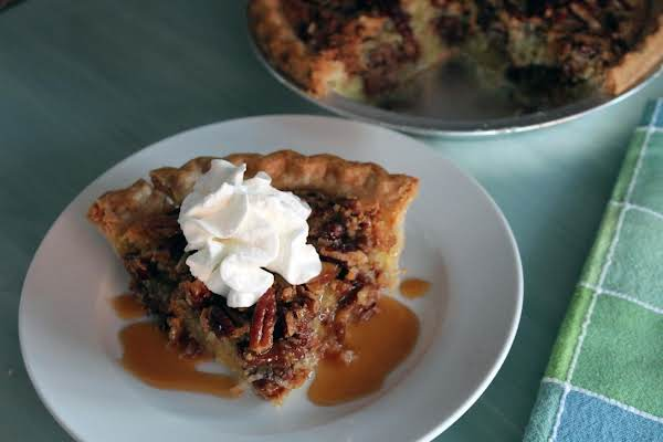 A Slice Of German Chocolate Vinegar Pie With A Dollop Of Whipped Cream