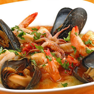 Seafood Medley with Tomato-Butter Sauce and Soft Polenta.