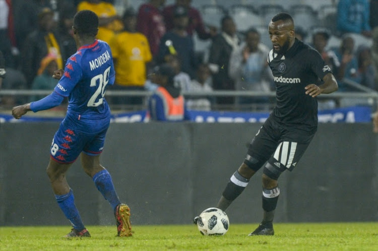 Mpho Makola of Orlando Pirates and Teboho Mokoena of Supersport United during the Absa Premiership match between Orlando Pirates and SuperSport United at Orlando Stadium on December 05, 2017 in Johannesburg.
