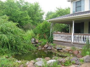 Photo: Pond and mini waterfall by front porch.  Photo from last summer.