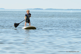 Photo: This little guy is during an amazing job paddle boarding at Sandbar State Park by Raven Schwan-Noble