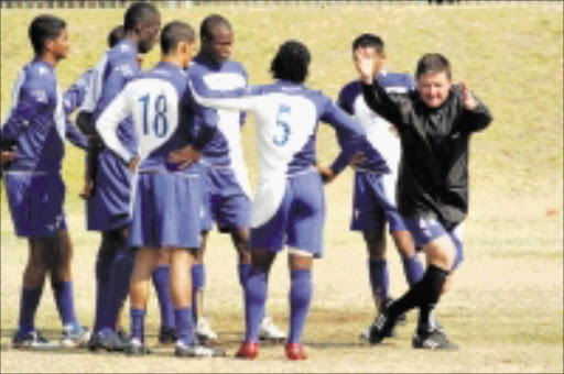 HANDS ON: SuperSport United's coach Gavin Hunt takes his charges through theIR paces during training in Pretoria yesterday. Pic. Veli Nhlapo. 21/08/08. © Sowetan.