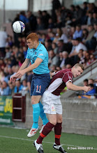 Photo: Stenhousemuir fc v Dunfermline fc, Scottish League 1, Ochilview , 24-08-13Ryan Thomson outjumps Nicky Devlin(c) David Wardle