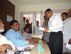 Photo: Dr. JP fulfilling the necessary formalities on the day of polling - GHMC Elections