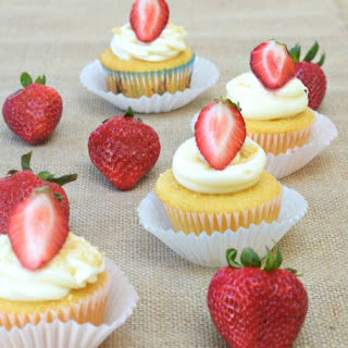 Strawberry- Filled Cupcakes with Cream Cheese Frosting.