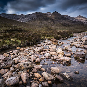 Stones river. by Haim Rosenfeld - Landscapes Waterscapes ( exposure, scotland, old, europe, mountain, colorful, ruin, land, stone, rock, landscape, long, shot, mountains, sky, kingdom, nature, movement, ruins, long exposure, rock formation, light, foreground, clouds, wind, uk, united, windy, grass, dream, green, beautiful, mood, scottish, image, highlands, photo, picture, great, blue, moody, scene, brown, scenery, stunning, medieval, britain, river )