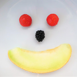 A fruit face by Svetlana Saenkova - Food & Drink Fruits & Vegetables ( red, black, yellow, berries, melon, funny, humorous )