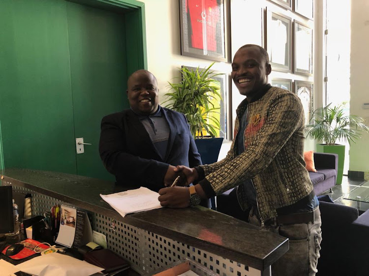 "Chippa United chairman and owner Siviwe ""Chippa"" Mpengesi smiles for the cameras alongside new signing Gift Motupa who joined a three-year deal from Orlando Pirates, the club announced on Tuesday May 15 2018."