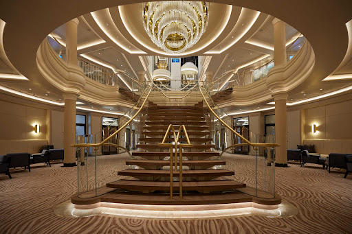 The atrium staircase of Seven Seas Splendor.