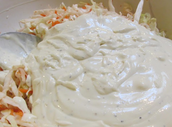 Add mayonnaise mixture to shredded cabbage & carrots, and stir till mixture is evenly...