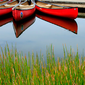 Red canoes by Gwen Paton - Transportation Boats ( water, fairy stone state park, reflection, lake, virginia, red canoe,  )