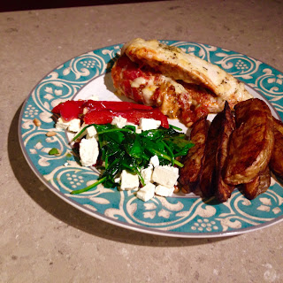 Stuffed Chicken Parmesan, with home made potato wedges and sautéed spinach and capsicum with feta.
