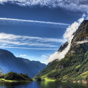 Majestic Norway by Conor MacNeill - Landscapes Mountains & Hills ( clouds, bergen, water, mountain, europe, scandinavia, sun, norway, fjord, mountains, sky, village, river )