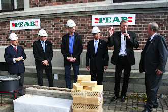 """Photo: 7 May 2012 WMU Chancellor E.E. Mitropoulos, Chairman of the City of Malmö Executive Board Ilmar Reepalu, PEAB Region Manager Ola Ohlsson, IMO Secretary-General Koji Sekimizu, Architect Kim Utzon, and WMU President Dr. Björn Kjerfve at the ceremonial bricklaying for the new WMU building. Kim Utzon produced a """"neutral"""" Swiss coin to place in the mortar as a nod to the shipbuilding tradition of placing a coin under the mast for good luck."""