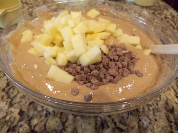 Stir in apple chunks and cinnamon chips. Pour into greased and floured bundt pan.