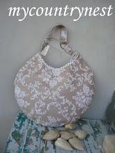Photo: rounded bag tessuto tappezzeria bicolor lato a