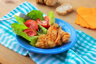 Photo: fried cod fish with fresh salad of lettuce  and Tomatoes
