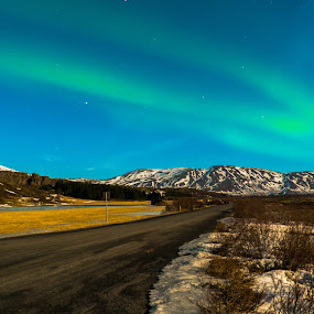 Northern Lights by Luke Albright - Landscapes Starscapes ( northern lights, sky, road, night, iceland, moiuntain, landscape )