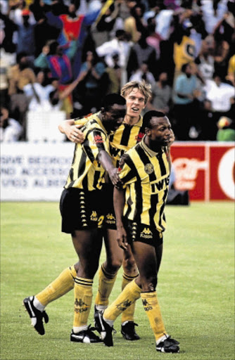 HAPPY SOULMATES: Kaizer Chiefs defender Rudolph Seale is congratulated by teammates after scoring. Photo: Gallo Images